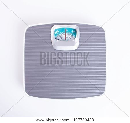 Weighing Machine Or Retro Style Weighing Machine On Background.