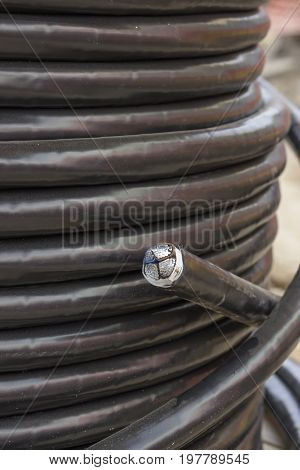 Electric Black Industrial Underground Cable On Large Wooden Reel