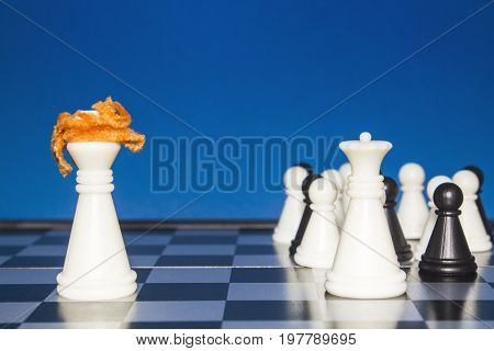 Chess As A Policy. A Lone White Figure With Red Hair Against A White Figure With A Team.