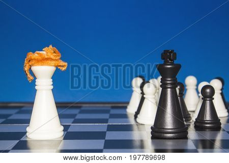 Chess As A Policy. A Lone White Figure With Red Hair Against A Black Figure With A Team.