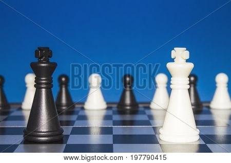 Chess As A Policy. A Lonely Black Figure Against A Lone White Figure. A Small Group Of The Public Lo
