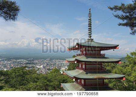 Mt. Fuji with red pagoda in summer time Fujiyoshida Japan