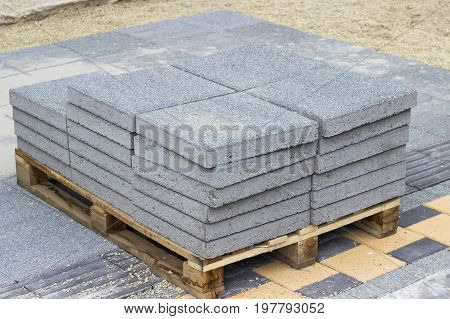 Wooden Pallet With A Paving Stone
