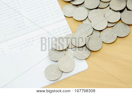 The passbook and coins, money, currency, finance