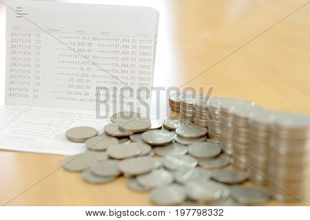 Passbook and coins for Save money concept