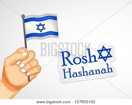 illustration of hand holding Israel flag with Rosh Hashanah text on the occasion of Jewish New Year Shanah Tovah. Translation: a good year