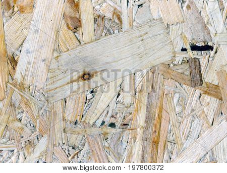 Particle board abstract wooden background. Close up image
