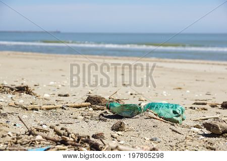 Polluted beach. Discarded plastic bottles and wastes on a beach