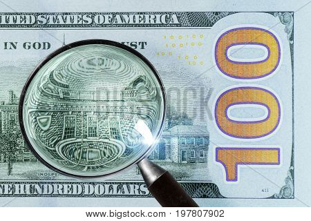 100 Us Dollar Under Magnifying Glass