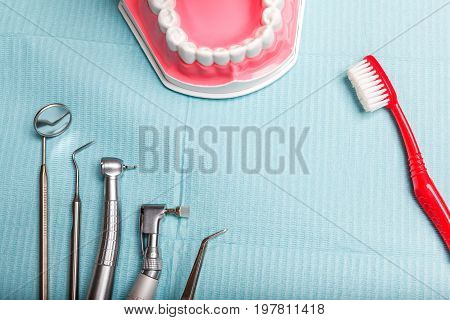 dental and endodontic instruments on the napkin. Top view