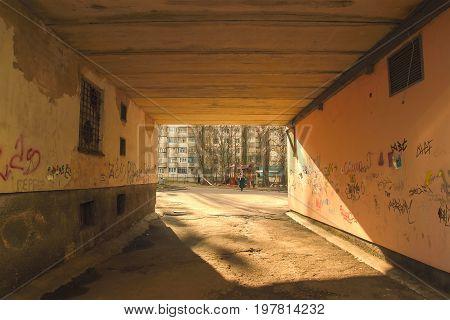 Old city hidden passageway through the building at sundown