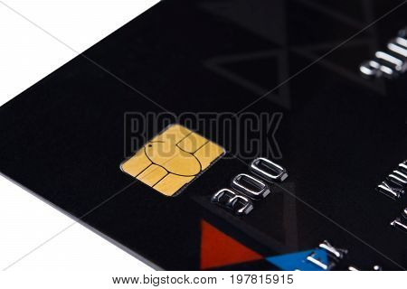 Card for payment online with a gold chip on a white background