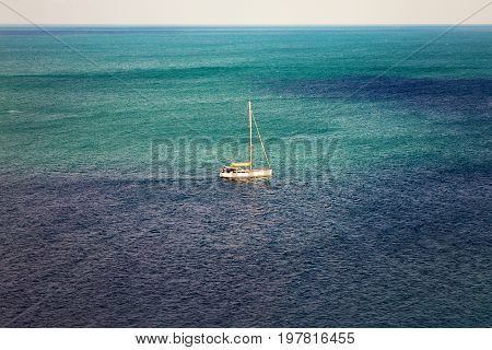 Beautiful Landscape With The Horizon Of The Sea And A Sailboat In The Calm Waters Of The Sea In The
