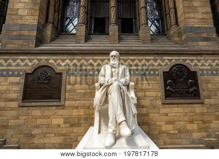 London UK - July 25, 2017: The Charles Darwin marble statue decorating the Hintze hall in the Natural History Museum of London