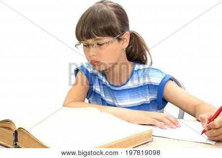Cute teenager with books on white background, serious face