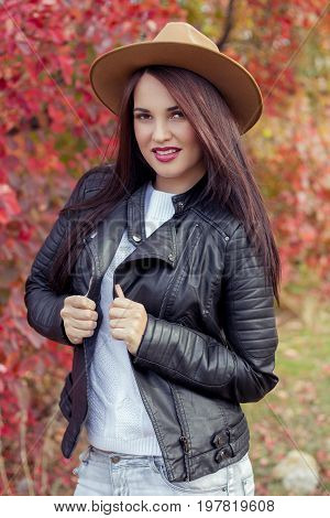 Young Beautiful Woman In A Hat And Jacket In Autumn Park. Warm Autumn. Autumn Portrait Of A Happy Gi