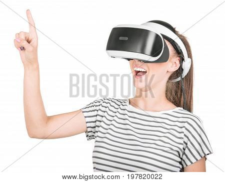 A young woman is using a 3D virtual reality headset isolated on a white background. Professional audio equipment. A girl in virtual reality goggles. VR Glasses. Female action in virtual reality helmet