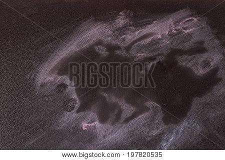 Blackboard chalkboard texture. Empty blank black chalkboard with chalk traces