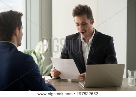 Excited recruiter impressed by career achievements in resume of applicant, surprised businessman amazed by good news in business letter, employee getting great opportunity in written notification
