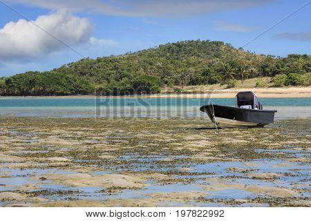 a boat on the beach as the tide has gone out