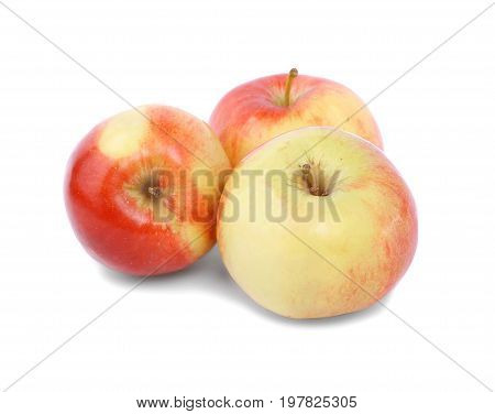 A close-up picture of three whole apples isolated over the white background. A group of three colorful and fresh apples. Nutritious and healthful breakfasts and snacks. Tasty summer fruits.