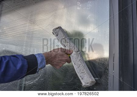 Hand Cleaning Window Of A Building 2