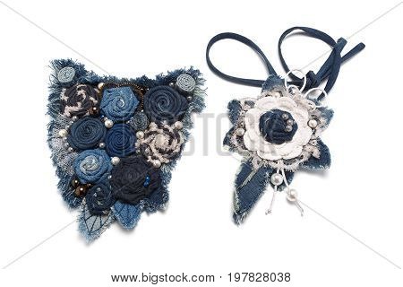 Pendant and handmade necklace made from denim fabric on a white background