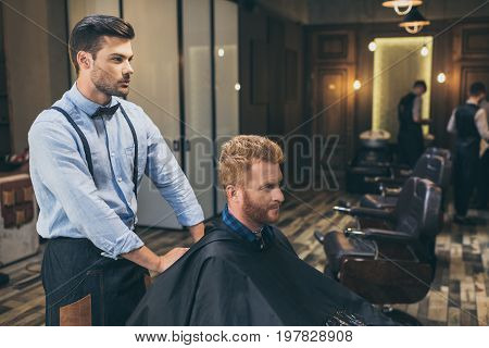 Barber With Customer In Barber Shop