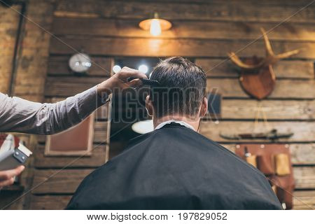 Barber Combing Hair Of Customer