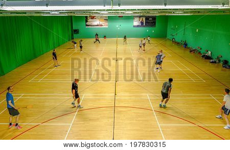 Redbridge Essex - June 6 2017: Social badminton at the sport's centre in Redbridge with players on court.