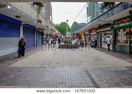 Poplar London UK - July 16 2017: Vesey Path Chrisp Street on a Sunday with shoppers. Area looking run down.