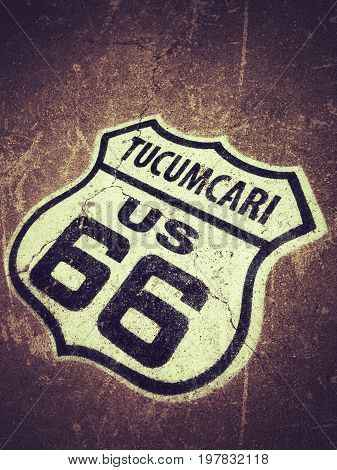 Route 66 sign painted on the road in Tucumcari