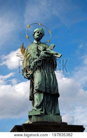 Statue of St. John Nepomucene in Charles bridge. Prague.