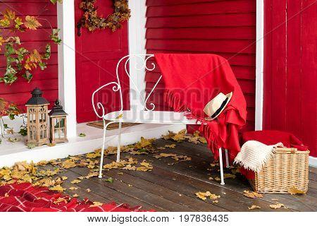 Autumn picnic on the terrace. Veranda of countryside house in autumn season