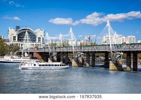 Golden Jubilee Bridge With Boat In London, England, Uk