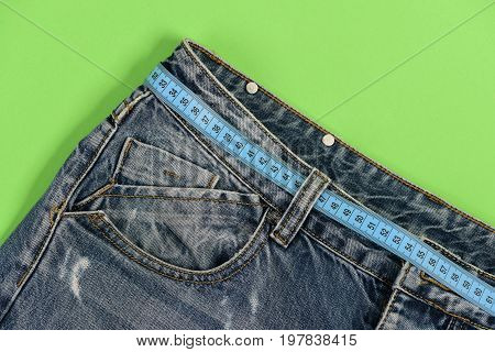 Denim Trousers And Measure Tape As Dieting Concept