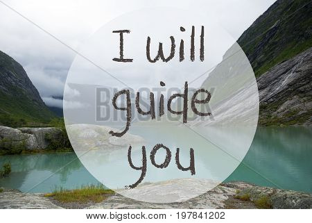 English Text I Will Guide You. Lake With Mountains In Norway. Cloudy Sky. Peaceful Scenery, Landscape With Rocks And Grass. Greeting Card