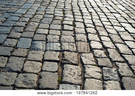 stone pavement in perspective. grey block texture