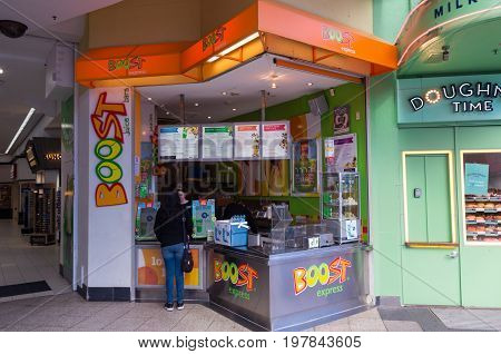 Gold Coast, Australia - July 12, 2017: Boost Juice is an Australian juice bar chain. This outlet is on Cavill Avenue in Surfers Paradise.