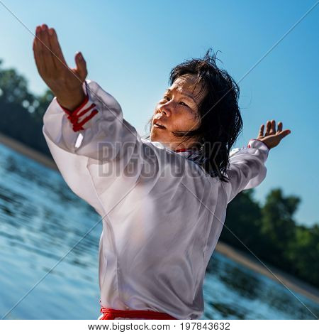 Tai Chi Training By The Lake, Color Image, One Woman Only