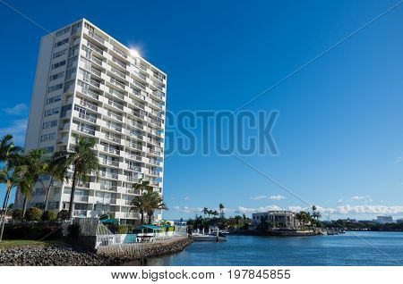 Gold Coast, Australia - July 12, 2017: modern apartment buildings on the banks of the Nerang River in Surfers Paradise, part of the rapidly growing Gold Coast City.