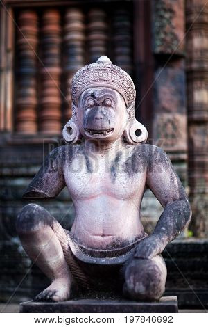 Ancient statue of Hindu God Hanuman in Banteay Srey Temple in Angkor Area, Cambodia. Banteay Srey is a 10th century Cambodian temple dedicated to the God Shiva