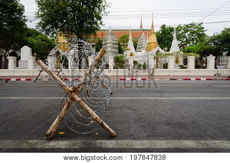 barricades and barbed wire in front of the royal palace during the 2014 protests.