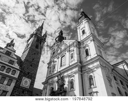 Black Tower and The Church of Virgin Mary's Immaculate Conception and St. Ignatus in Klatovy, Czech Republic. Black and white image.