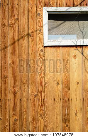 The Wall Of An Old Wooden House Made Of Thin Vertical Slats. Weathered And Aged Boards.