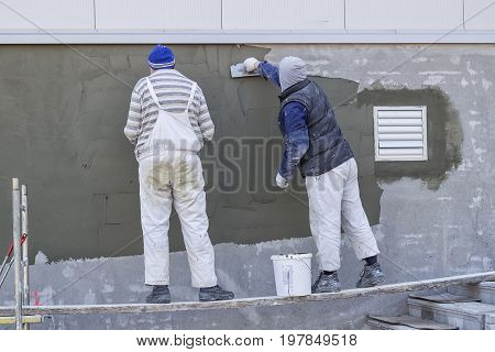 Workers Plastering A Outdoor Wall 3
