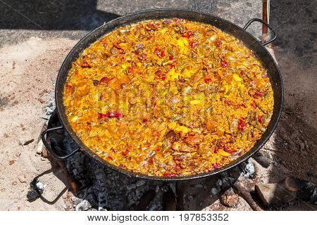 Seafood Paella.The national Spanish dish of paella in a large skillet is cooked on an open fire, at the stake
