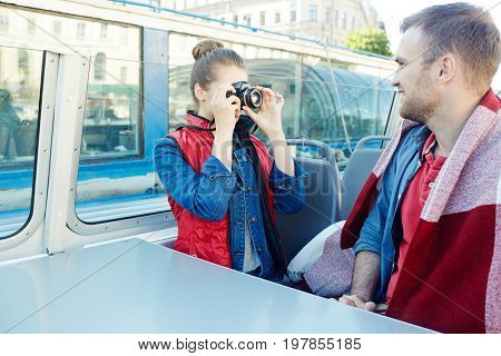 Girlfriend photographing young man during voyage