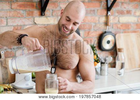Handsome, shirtless man at kitchen