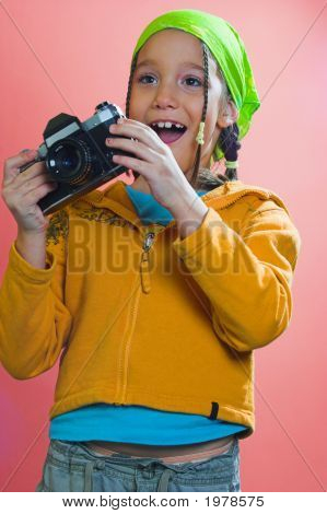 Excited Girl Holding A Camera